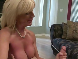 Blonde busty milf jacks cock